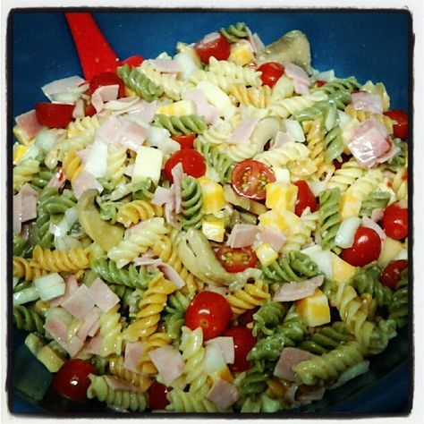 Pasta salad for hot weather. Tri color pasta, chopped up ham lunch meat, onions, mushrooms, baby tomatoes, cubed cheese, Italian dressing & parmesan cheese shaken all over & mixed. Serve Cold.