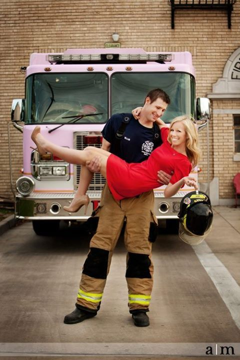 Adorable engagement photo. Firefighter holding his woman in red.  A modern fairy tale.