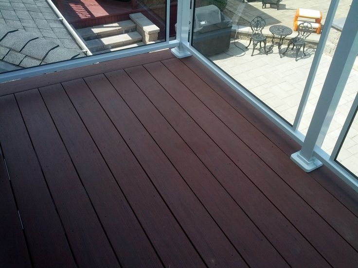lovely decking with glass railings... by bluedog EXTERIORS
