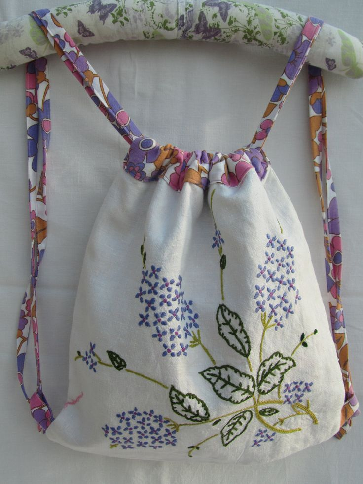 Drawstring backpack from recycled embroidered tablecloth, lined with vintage sheet.