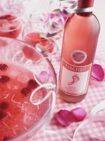 Combine in a pitcher the Barefoot Pink Moscato, pink lemonade concentrate, and lemon-lime soda (more or less depending on your taste)., Mash half a container of raspberries and add to the pitcher., Place the remaining whole raspberries in glasses, add pitcher mixture and ice if desired.