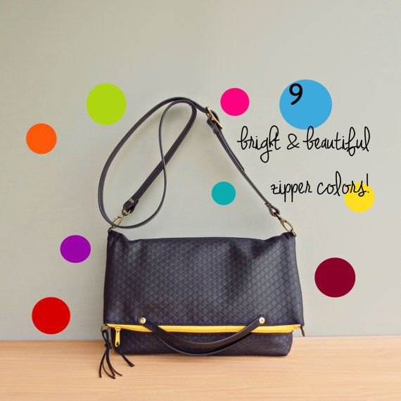 Convertible foldover purse that can be used as a messenger bag, shoulder bag or tote. Made of a wonderful outdoor grade fabric coated in