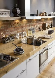 Butcher block counters are my favorite. Mixing with the rough brick back splash and stainless steel is awesome. Would do,