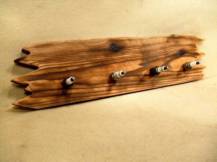 Rustic Coat Hook Design Inspirations with Neutral Wooden Trunk Hook Rail and Unique Four Spark Plug Hooks for Wall Mounted Furniture