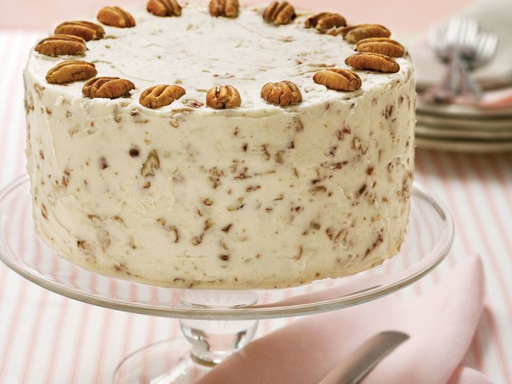 Italian Cream Cake Recipe | If you're looking for an impeccable dessert to complete your holiday dinner party, we've got the one for you! The Italian Cream Cake isn't actually Italian; it's more Southern than anything. The decadent dessert is the perfect treat to put on your holiday table because it's incredibly beautiful, elegant, and of course, tasty. It's a seasonal white, three-layer cake that's complete with cream cheese, pecans, and coconut in the frosting.