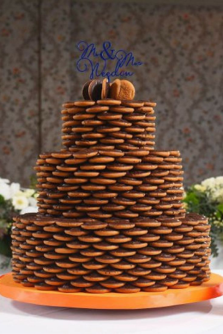 Tristan and Maria Weedon absolutely love Jaffa Cakes. They've loved them since the start of their 11 year relationship, and they will never stop loving them. So it was fitting that they had a jaffa cake wedding cake.
