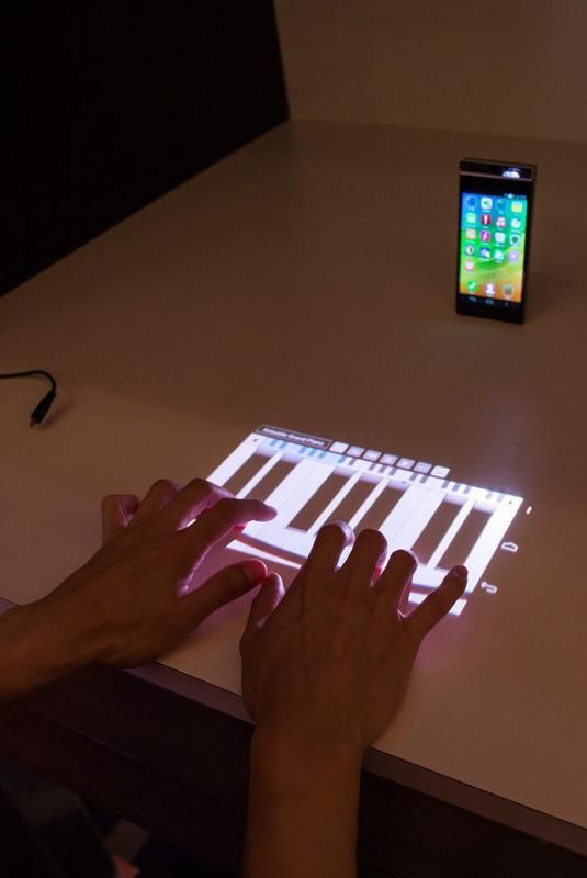 phone that projects keyboard The minuum keyboard project walmsley has invented a diverse range of interaction techniques ranging from bendable mobile phones to novel 3d surgical displays to.