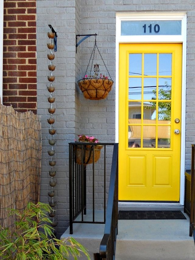 From 110 + 2: She gives a great DIY for this very cool rain chain. BTW: LOVE their back door.