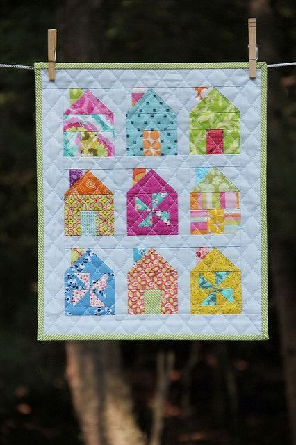 This past weekend I needed a quick and fun project to do. Camille's Mini Dwell houses were fun to make and I just dug through the scrap boxes to find fabrics. Some of them used the tiniest pieces!I ha