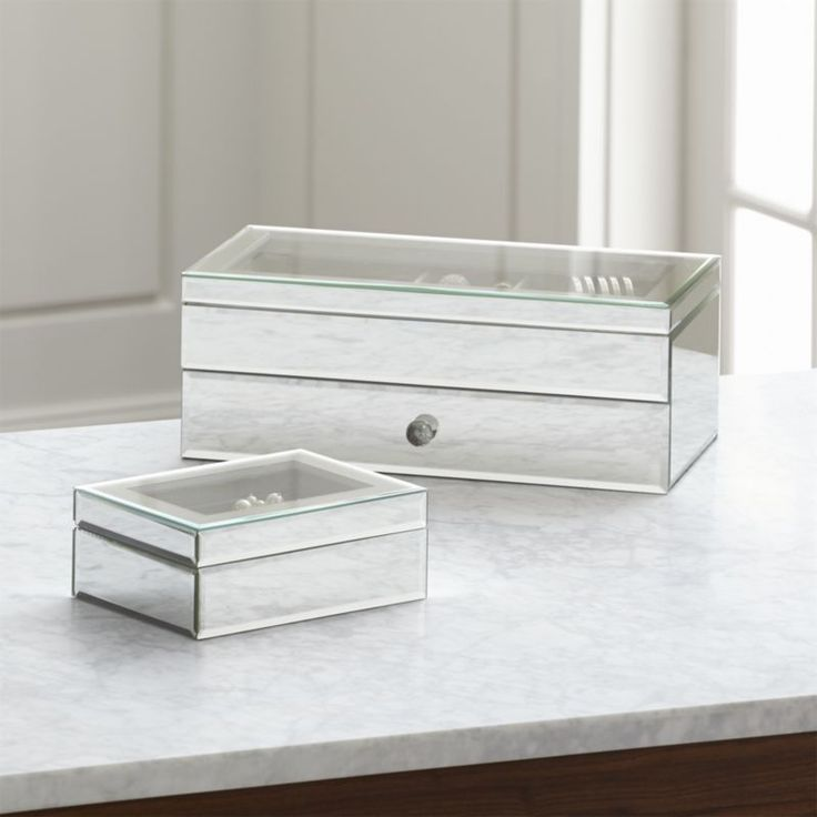 Shop Eleanor Mirrored Jewelry Box.  Recalling the glamour of Art Deco design, this mirrored jewelry box has a clear glass lid and a divided interior covered in natural linen.