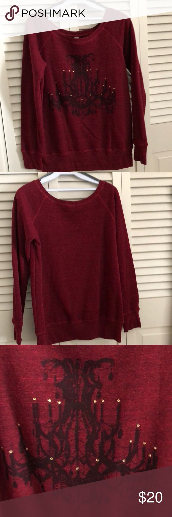 Ladies sweatshirt This is a ladies sweatshirt in a wine color with a chandelier in the front. Also has some crystals. It is size small , only worn once, great shape. Runs large for a small. Has bands on the sleeves and the bottom. bella Tops Sweatshirts & Hoodies