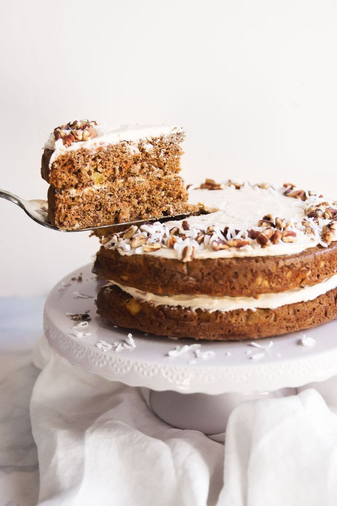 A lightened up gluten free carrot cake made from a mixture of almond and oat flour. Topped with a lovely, thick cinnamon cream cheese frosting! Perfect for parties, Easter, or any holiday!