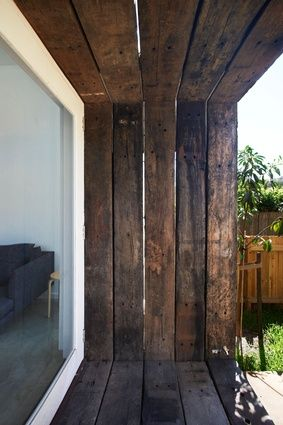 Detail of timber sleepers framing French doors. - David Boyle adds a new first floor to a narrow Sydney semi
