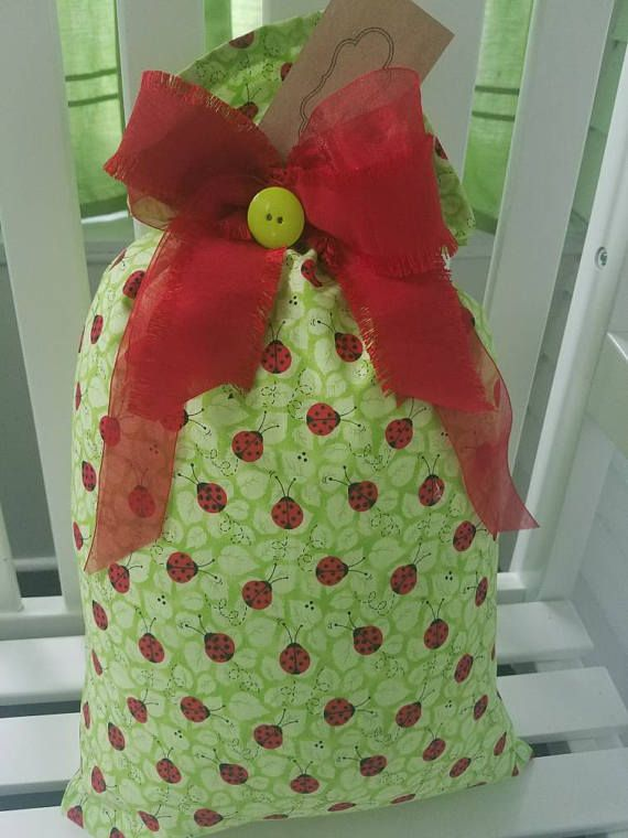 Check out this item in my Etsy shop https://www.etsy.com/listing/518035618/green-traditions-fabric-gift-bag