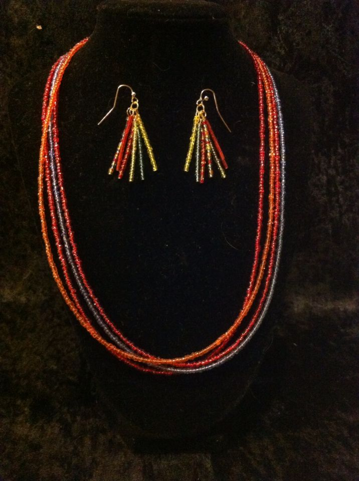 Multi strand multi colored necklace with match tassel earrings.