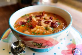 Zoo Soup-Soak dry navy beans overnight. Put in crockpot- replace water. Add ham hocks,Chicken boullion cubes (2) garlic,liquid smoke, salt and pepper. Cook till beans are not quite tender. (4-6 hours) Add celery, onion, carrot, parsley. Finally take meat off ham bones.Add. Heat.