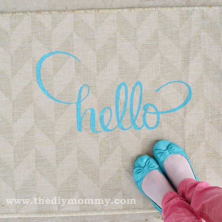 """Materials: HESSUM door mat Description: To dress up a plain HESSUM door mat, I used leftover latex paint and a stencil I made on my computer to add this cute """"Hello"""" design. I finished the hack by spraying the design with Scotch Gard protectant spray. It only took me a couple of hours and it [&hellip"""
