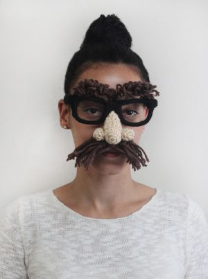 Make this mustache-y disguise as a gag gift, photo booth prop (perfect for a wedding or bridal shower!), or low-key Halloween costume, from LionBrand.com