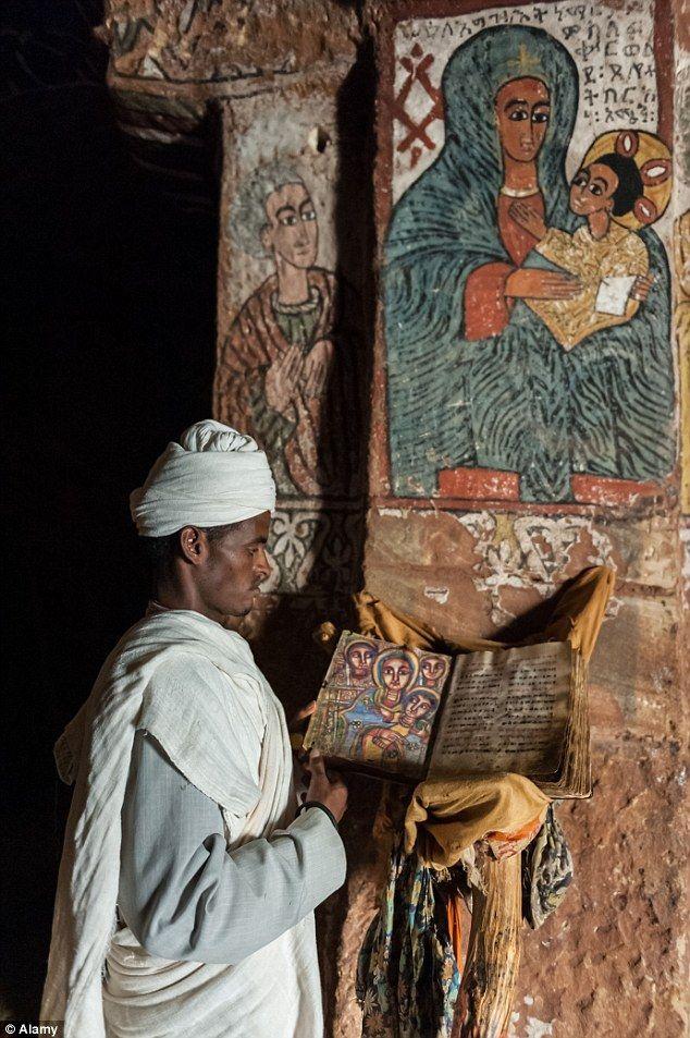 An Orthodox monk inside Abuna Yemata Guh church, Tigray, Ethiopia, Africa...