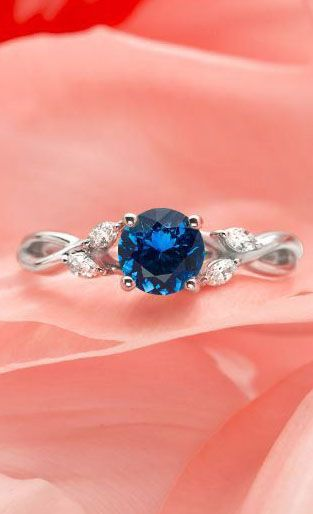 Love this nature inspired ring with dazzling marquise diamond accents.