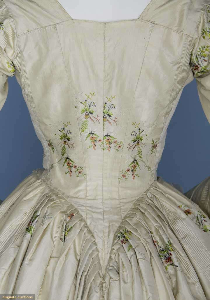 Back detail of SILK BROCADE ROBE A L'ANGLAISE, 1770-1790s 3-piece cream silk damask w/ sprays of polychrome flowers: lace front bodice w/ attached back skirt train, petticoat & ribbon & lace trimmed stomacher
