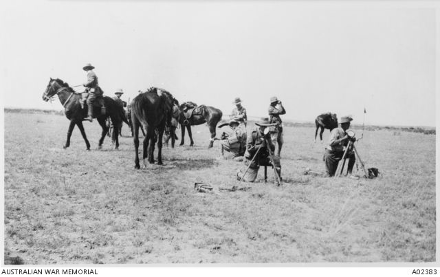 Signallers of the 1st Australian Light Horse Brigade using heliographs to contact columns during a brief stop. General C Cox is seen between the two horses in the left background, wearing a pith helmet. Sapper Dinning is at the left heliograph and Sapper Woods of the 1st Signal Troop is at the right heliograph..23 May 1917