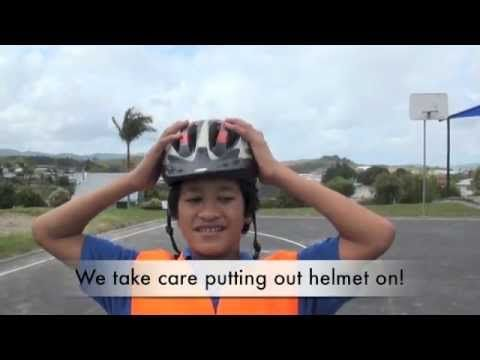 Blomfield Special School students look at the gear they use, and demonstrate the hand signals and other safe practices they follow when practising their cycling.