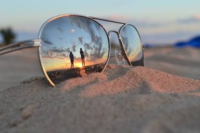 Beach Sunglasses - How sweet would it be to capture the beach propsal on the lens of sunglasses?
