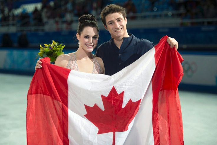 Canada at Sochi Games - Day 10 of Competition |  CTV News at Sochi 2014  ~~ Canada's Silver Medalist's Tessa & Scott pose with the Canadian Flag during the flower ceremony at the Iceberg Skating Palace. Feb 17, 2014.