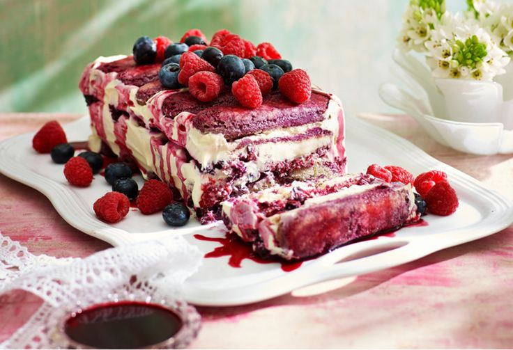Berrymisu is one attractive dessert! Take a slice from this frozen cake and watch as the bright berries begin to melt into the vanilla bean and mascarpone flavoured chilled cream and sponge finger biscuits.