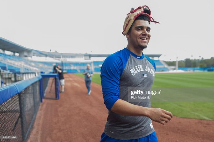 Pitcher Roberto Osuna with his glove on his head as he heads back to the club house after tossing the ball. Toronto Blue Jays begin to assemble at Florida Auto Exchange Stadium as the Jays prepare to open Spring Training camp. Pitchers and catchers must report for medicals today followed by full workouts on Wednesday as the team prepares for the 2017 pre season of Major League Baseball. Toronto Star/Rick Madonik