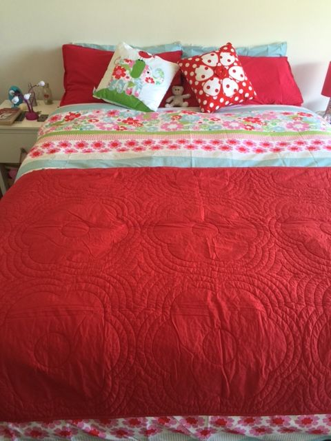 Loving the Daisy red comforter with Charlotte duvet cover, teamed with the elephant & spotty flower cushions. Great combo!!