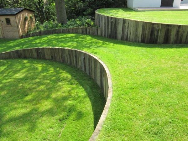 Sleeper retaining wall on pinterest a selection of the for Curved garden wall designs