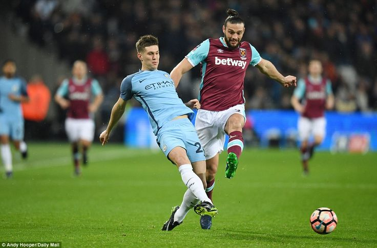 Stones plays the ball under pressure from Hammers striker Andy Carroll on what turned out to be a comfortable night for City
