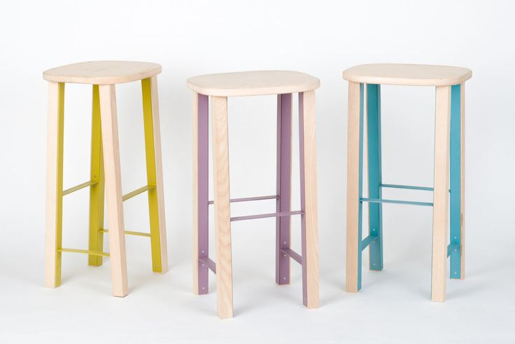 The flat-pack, wooden Antilope stool highlights the functional parts with a colorful metal structure as a design feature instead of hiding them.