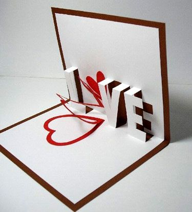 handmade pop-up Valentine spelling the word LOVE ... replace the O with a heart shape that spirals open ... clever!!