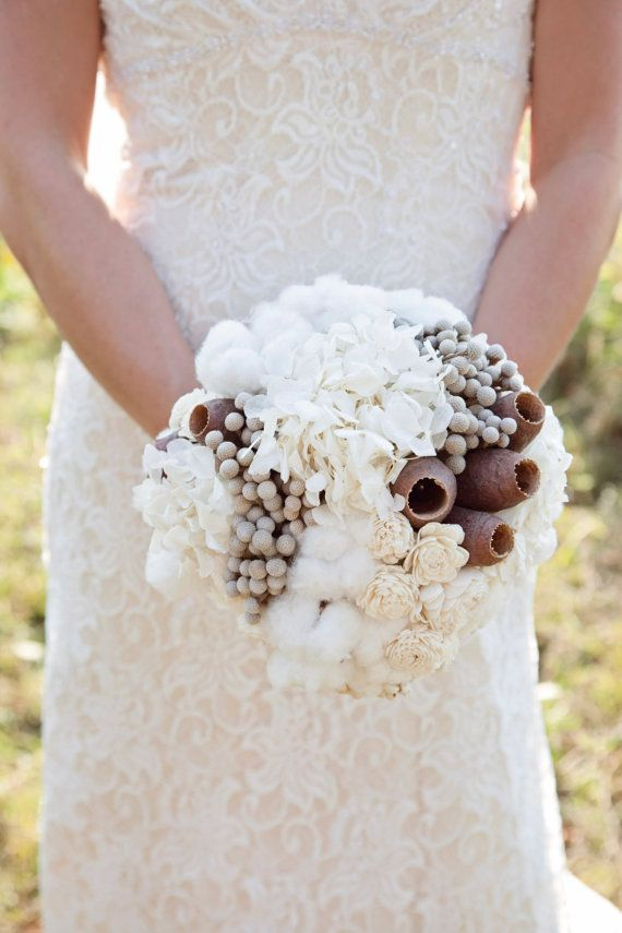 Wedding bouquet made with Hydrangeas, Silver Brunia, Dusty Miller, Sola Flowers, Button Flowers, Tallow Berries, Raw Cotton Bolls, and Trumpet Pods.