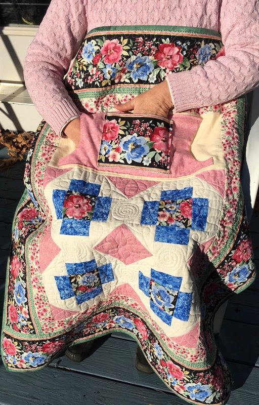 Blue and Pink Floral Lovie Lap Quilt with Pockets from http://www.homesewnbycarolyn.com