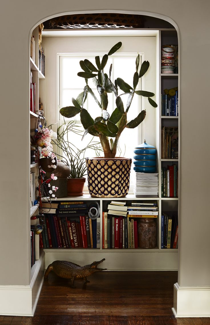 Pocket library in Liva Cetti and Danny Marrone's Spanish Mediterranean house remodel in the Bronx, photo by Kate Mathis |Remodelista