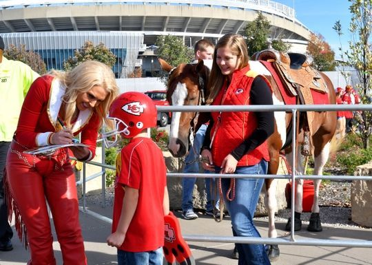 Jaguars vs. Chiefs  -  19-14, Chiefs  -  November 6, 2016  -  Nov 6, 2016; Kansas City, MO, USA; Seven year old Kansas City Chiefs fan Braden Moss gets an autograph from cheerleader Susie who rides the mascot WarPaint before a game against the Jacksonville Jaguars at Arrowhead Stadium. Mandatory Credit: Denny Medley-USA TODAY Sports