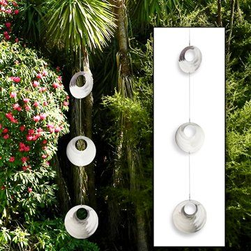 Stainless Steel Hanging CirclesA lovely addition to your secret garden!Effortless art - simply hang them from a tree or veranda. The beautifully shaped circles swivel in a breeze and catch the light.Worked by hand in stainless steel by artisan metal workers based in beautiful Mapua, they can hang inside or out.The trio of Circles are approx. 128cm long (from top of hanging loop to bottom of largest circle). The largest circle measures approx. 21cm / 8¼ inches in diameter.