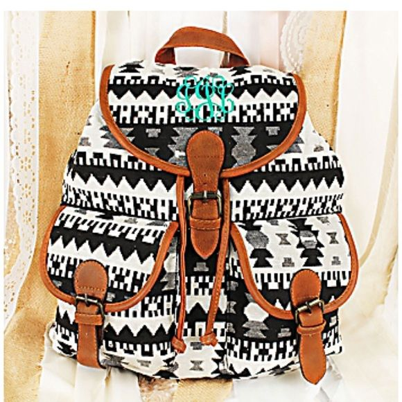 """Southwest black and white backpack! Fabric Construction with Faux Leather Trim * Goldtone Accents * Flap with Magnetic Snap and Drawstring Closure * 2 Front Magnetic Snap Pockets * Fully Lined with a Different Print * Inside Zip and Open Pockets * 2 Adjustable Shoulder Straps * 14"""" Tall x 13"""" Wide x 5.5"""" Deep  101015  *Does not come with green monogrammed design* Bags Backpacks"""