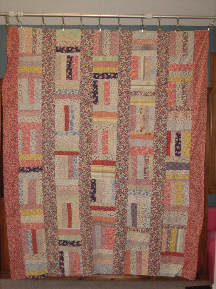 """String Quilt Top, @72""""x84"""". This is machine pieced onto feedsack foundation. I don't want to quilt it, because the back is so interesting - I have shown this to many student classrooms to explain about feedsacks being made into quilts in the 1930's/40's."""