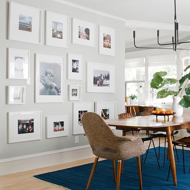 Loving how @em_henderson shows us that family pictures can indeed be incorporated in good design. They even used Ikea frames and just switched out the mats to bigger bright white ones. Makes me wants to hang up some of our pictures. I'm the worst procrastinator with that.