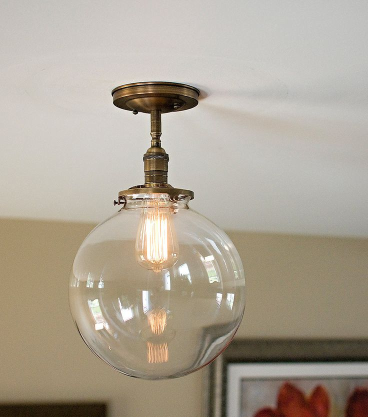 Large Clear glass globe flush mount light 12 globe Welcome to Olde Brick Lighting, My name is William Eichorst and I am an experienced electrician and lighting craftsman. I personally design, build and hand craft each of my lighting fixtures. A great deal of attention is given to detail and safety in every light I create. I am a firm believer in using high quality material and craftsmanship so that every light that comes out of my shop will not disappoint anyone. Here you are looking at a…