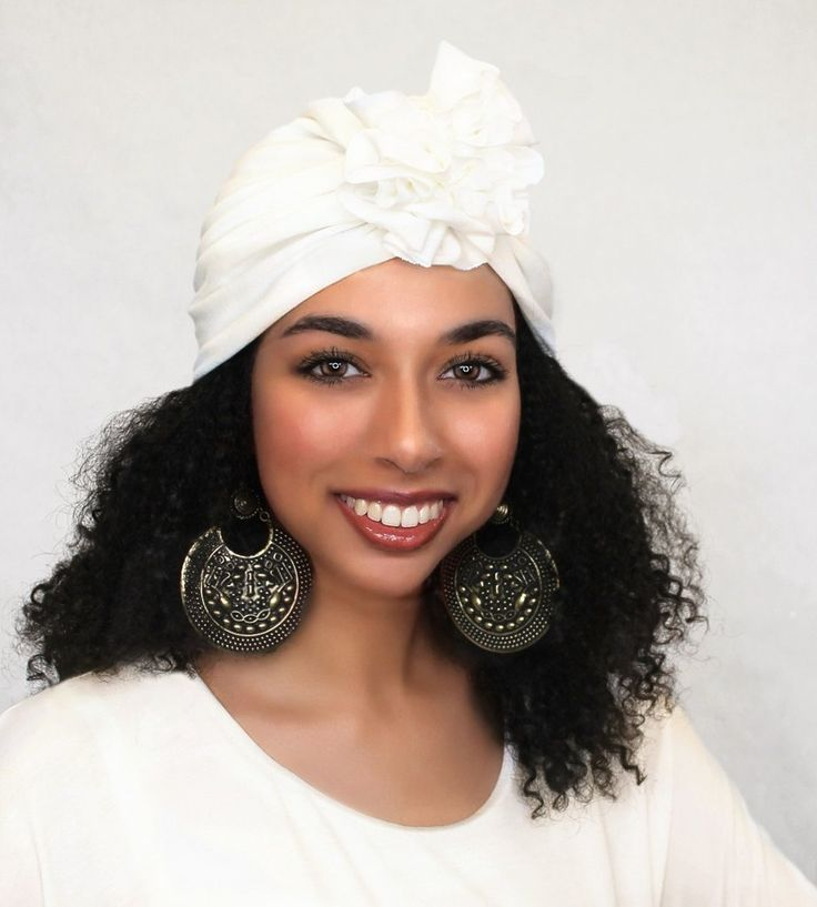 This sassy Creme Flower turban is made from Modal knit, a sustainable fabric that is buttery soft, light and strong and has excellent wicking properties. They are self-lined (double layer) soft, versa                                                                                                                                                     More