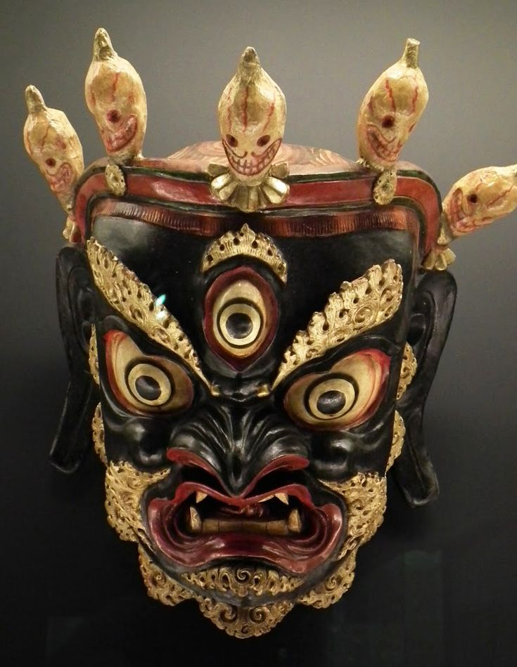Tibetan Mask:Bhairab with a crown of skulls and 3rd eye.  An avatar of Lord Shiva. He protects the home from negative energy.