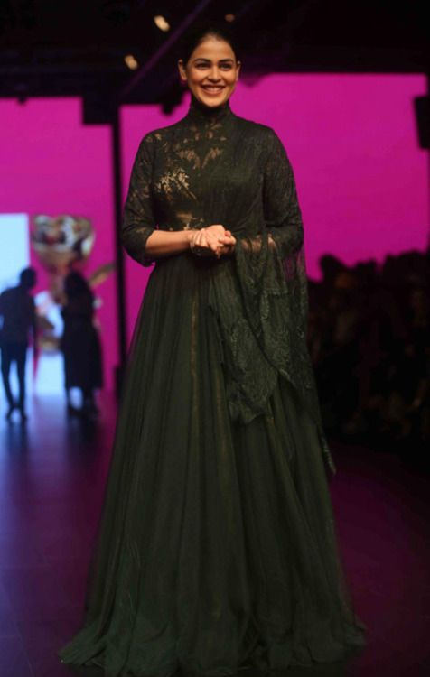 Genelia D'Souza at Lakme Fashion Week 2016 : Genelia looked beautiful in a green Shantanu and Nikhil dress which featured lace work and gold underlay. Keeping it minimal with accessories and makeup was a smart move. I like it.