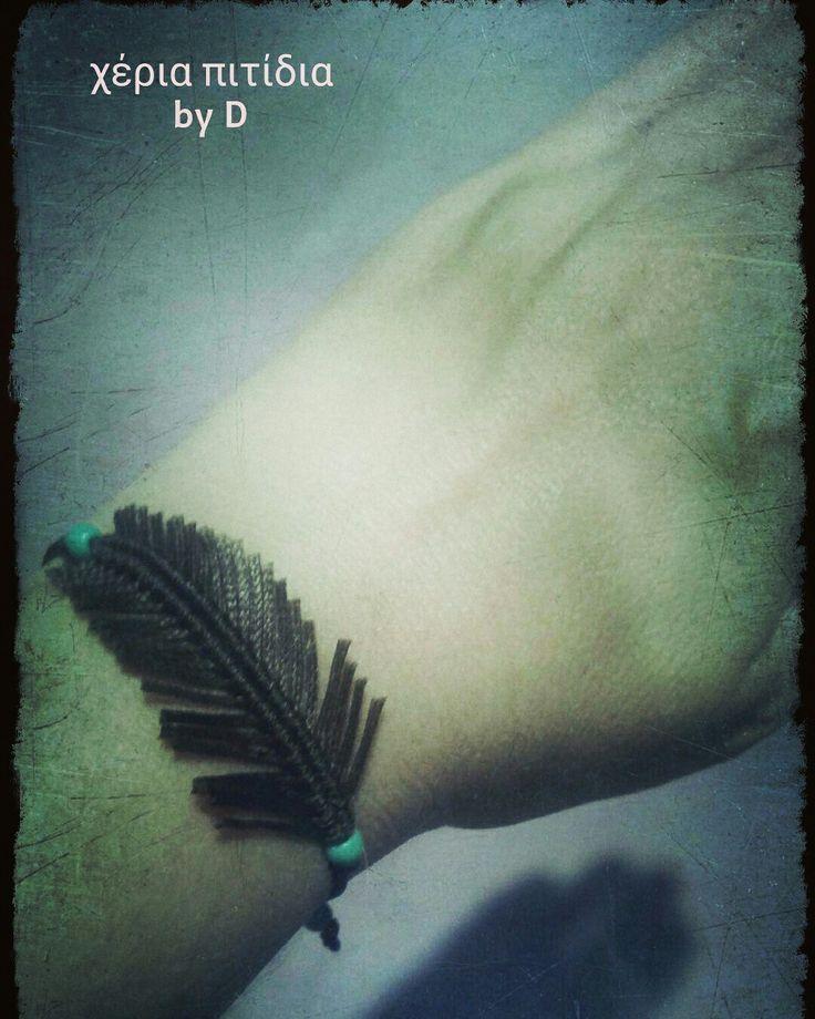Macrame feather bracelet.