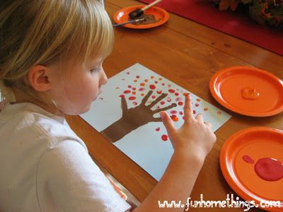 """Fall Crafts for Kids--Handprint Fall Tree .  Doing this!! I think I'll do it on cardstock and then frame it.  Paint the child's hand and part of their forearm; stamp it on the paper to make the tree, then use fingers to dot orange, yellow, and red """"leaves""""!!"""